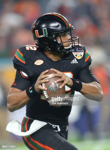 Malik Rosier of the Miami Hurricanes looks upfield as he runs out of the pocket with the ball against the Wisconsin Badgers during the 2017 Capital...