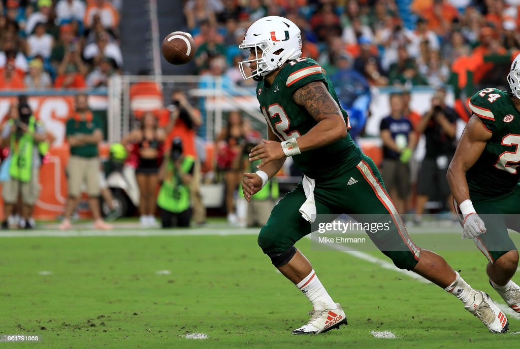 Malik Rosier #12 of the Miami Hurricanes loses the ball during a game against the Syracuse Orange at Sun Life Stadium on October 21, 2017 in Miami Gardens, Florida.