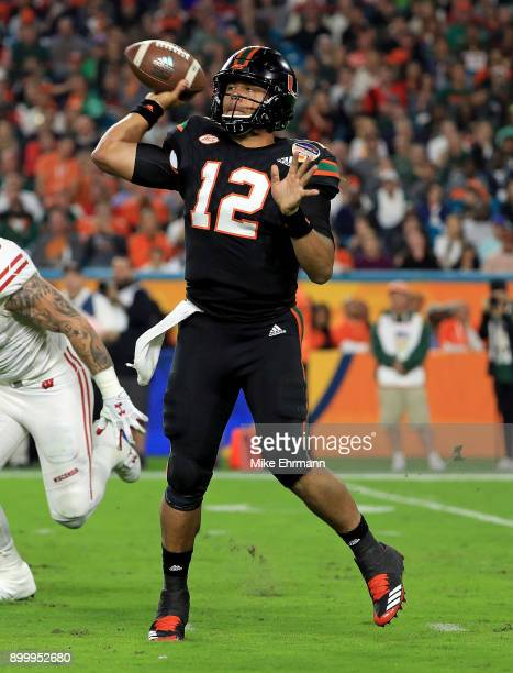 Malik Rosier of the Miami Hurricanes passes during the 2017 Capital One Orange Bowl against the Wisconsin Badgers at Hard Rock Stadium on December 30...