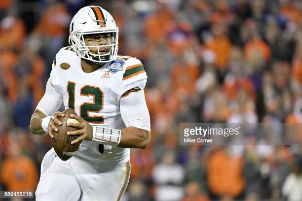 Malik Rosier of the Miami Hurricanes rolls out of the pocket against the Clemson Tigers during the ACC Football Championship at Bank of America...