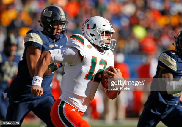 Malik Rosier of the Miami Hurricanes rushes against the Pittsburgh Panthers on November 24 2017 at Heinz Field in Pittsburgh Pennsylvania