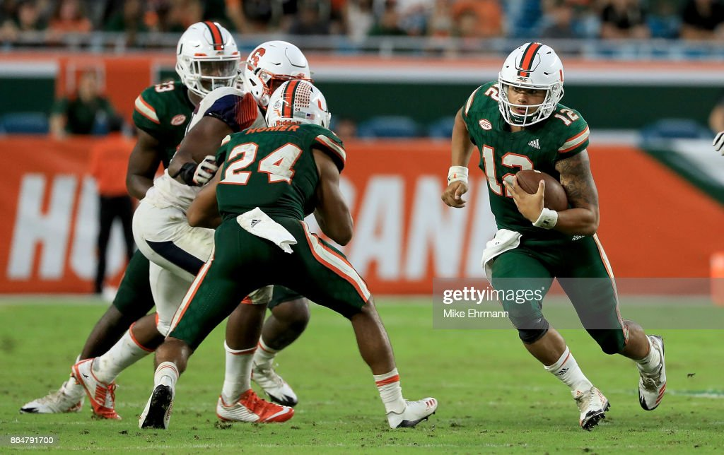 Malik Rosier #12 of the Miami Hurricanes scrambles during a game against the Syracuse Orange at Sun Life Stadium on October 21, 2017 in Miami Gardens, Florida.