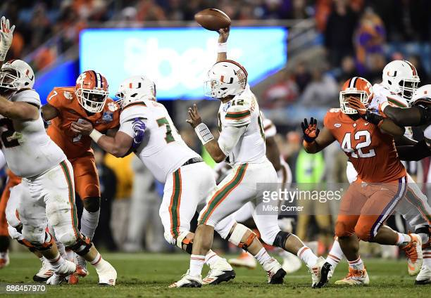 Malik Rosier of the Miami Hurricanes throws a pass against the Clemson Tigers during the ACC Football Championship at Bank of America Stadium on...