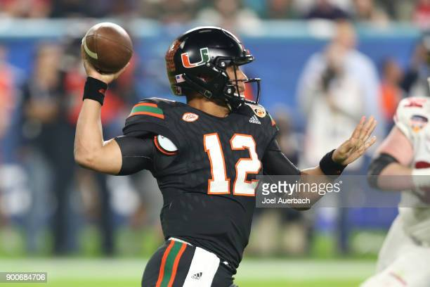 Malik Rosier of the Miami Hurricanes throws the ball against the Wisconsin Badgers during the 2017 Capital One Orange Bowl at Hard Rock Stadium on...