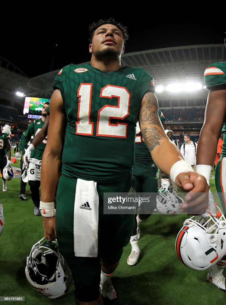 Malik Rosier #12 of the Miami Hurricanes walks off the field after a game against the Syracuse Orange at Sun Life Stadium on October 21, 2017 in Miami Gardens, Florida.