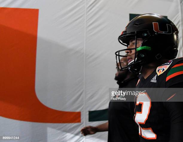 Malik Rosier of the Miami Hurricanes walks to the field before the 2017 Capital One Orange Bowl against the Wisconsin Badgers at Hard Rock Stadium on...