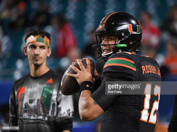Malik Rosier of the Miami Hurricanes warms up before the 2017 Capital One Orange Bowl against the Wisconsin Badgers at Hard Rock Stadium on December...