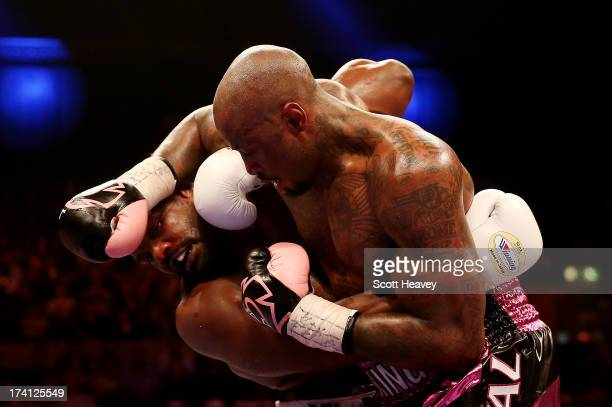 Malik Scott of USA in action with Dereck Chisora of England during their Vacant WBO International Heavyweight Championship bout at Wembley Arena on...