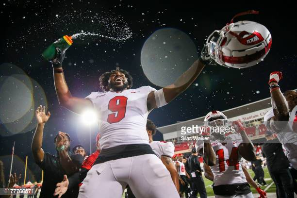 Malik Staples of the Western Kentucky University Hilltoppers sprays water while celebrating a victory against the University of Alabama Birmingham...
