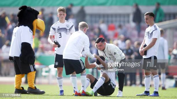 Malik Tillman and team mates of Germany U17 react after the UEFA Elite Round match between Germany U17 and Iceland U17 at EWR Arena on March 23 2019...