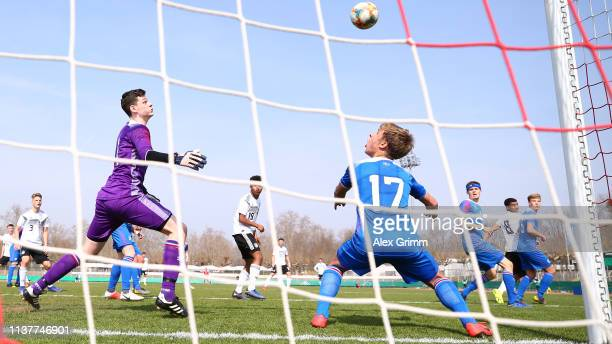 Malik Tillman of Germany U17 scores his team's second goal during the UEFA Elite Round match between Germany U17 and Iceland U17 at EWR Arena on...