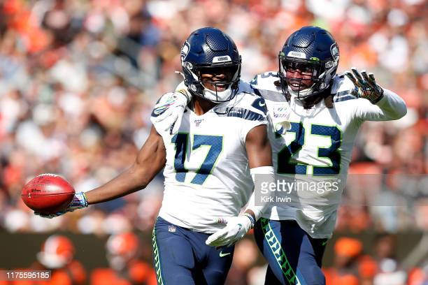 Malik Turner of the Seattle Seahawks and Neiko Thorpe celebrate after a blocked punt by David Moore during the first quarter of the game against the...