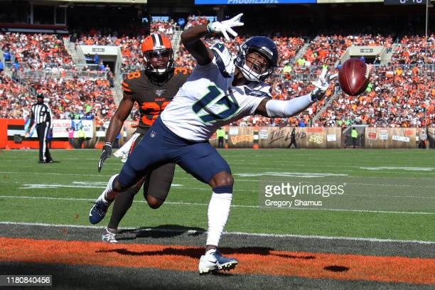 Malik Turner of the Seattle Seahawks can't pull in a third quarter touchdown pass in front of TJ Carrie of the Cleveland Browns at FirstEnergy...