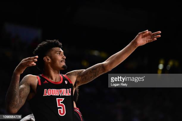 Malik Williams of the Louisville Cardinals celebrates from the sidelines against the Georgia Tech Yellow Jackets at Hank McCamish Pavilion on January...