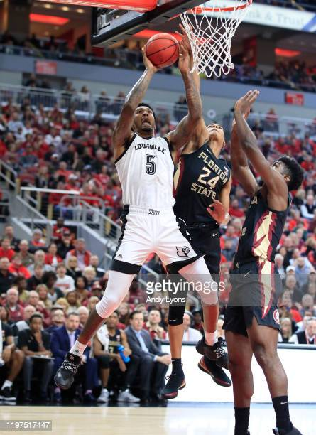Malik Williams of the Louisville Cardinals shoots the ball against the Florida State Seminoles at KFC YUM Center on January 04 2020 in Louisville...