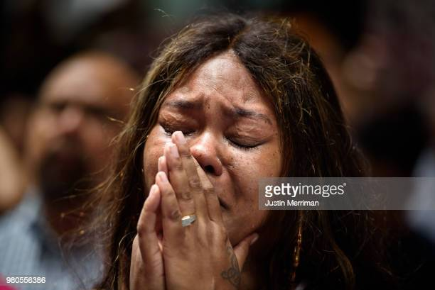 Malika CollinsBerry of Wilkinsburg Pa cries at a rally in front of the Allegheny County Courthouse on June 21 2018 in Pittsburgh Pennsylvania More...