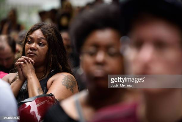 Malika CollinsBerry of Wilkinsburg Pa listens at a rally in front of the Allegheny County Courthouse on June 21 2018 in Pittsburgh Pennsylvania More...