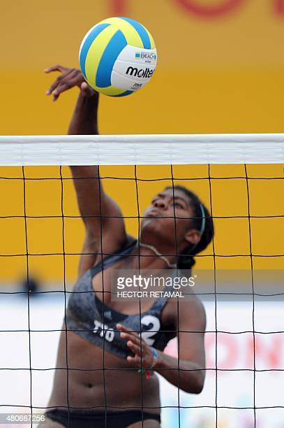 Malika Davison of Trinidad and Tobago hits the ball during the Women's Beach Voleyball Preliminary against Argentina at the 2015 Pan American Games...