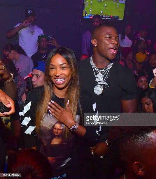 Malika Haqq and OT Genasis attend the Dazed and Blazed Concert after Party at Elleven45 on August 22 2018 in Atlanta Georgia