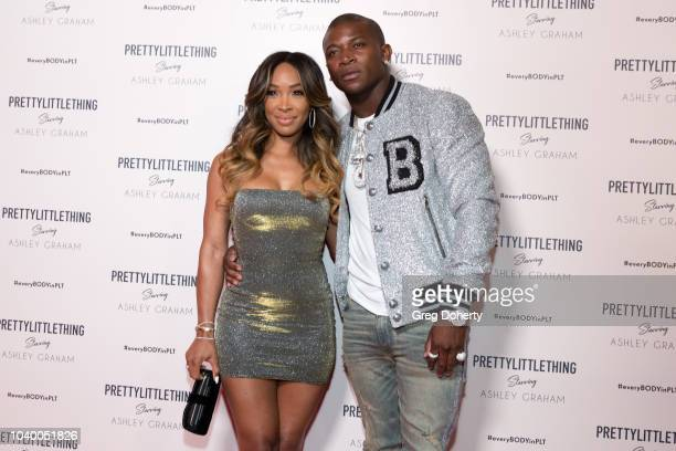 Malika Haqq and OT Genasis attend the PrettyLittleThing x Ashley Graham Event at Delilah on September 24 2018 in West Hollywood California