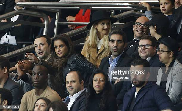 Malika Menard and her new boyfriend Michael Cohen Ary Abittan above Pascal Obispo and his wife Julie Hantson attend the French Ligue 1 match between...