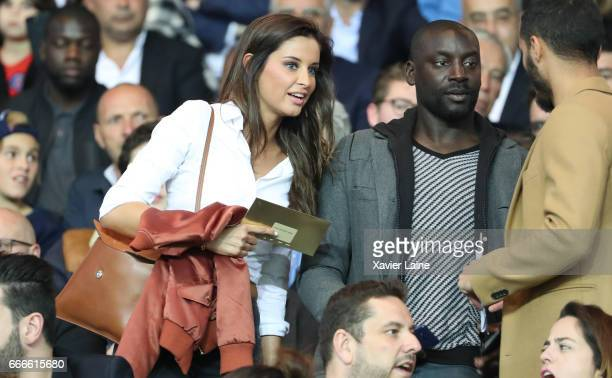 Malika Menard and Ladji Doucoure attend during the French Ligue 1 match between Paris Saint Germain and EA Guingamp at Parc des Princes on April 9...