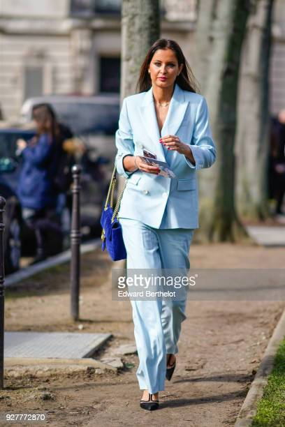 Malika Menard wears a blue suit and blazer jacket a blue Gucci bag during Paris Fashion Week Womenswear Fall/Winter 2018/2019 on March 5 2018 in...