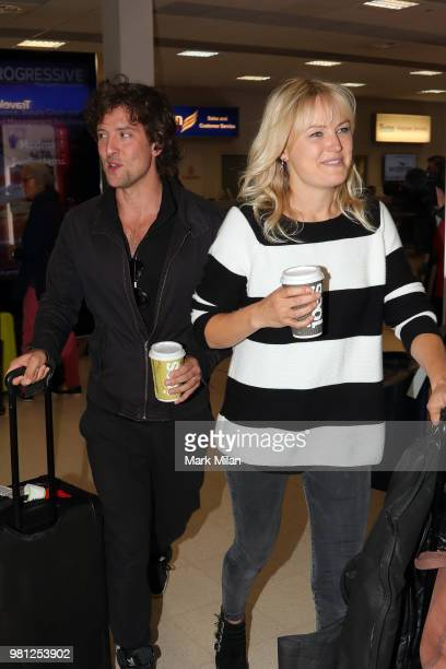 Malin Akerman and Jack Donnelly arriving at Aberdeen Airport before the wedding of Kit Harrington and Rose Leslie on June 22 2018 in Aberdeen Scotland