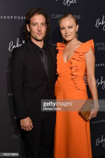Malin Akerman and Jack Donnelly attend the 4th Adopt Together Baby Ball Gala on October 19 2018 in Los Angeles California