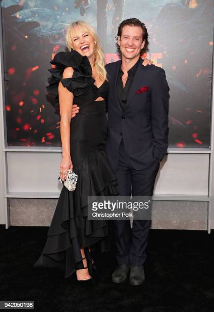 Malin Akerman and Jack Donnelly attend the premiere of Warner Bros Pictures' Rampage at Microsoft Theater on April 4 2018 in Los Angeles California
