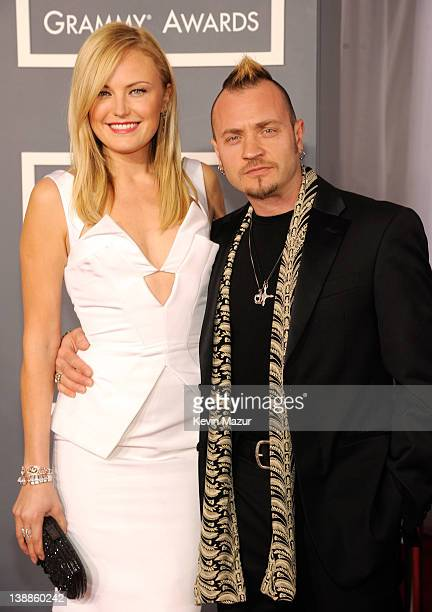 Malin Akerman and Roberto Zincone arrive at The 54th Annual GRAMMY Awards at Staples Center on February 12 2012 in Los Angeles California