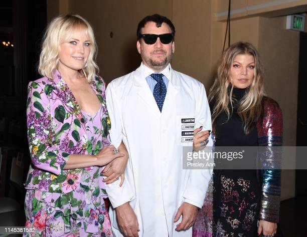 Malin Akerman, Johnson Hartig and Fergie attend the Libertine Fall 2019 Runway Show at Ebell of Los Angeles on April 26, 2019 in Los Angeles,...