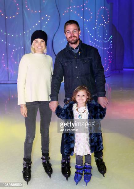 Malin Akerman Roberto Zincone and Sebastian Zincone attend Disney On Ice Presents Dare to Dream Celebrity Skating Party at Staples Center on December...