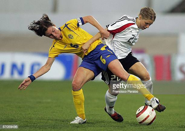 Malin Mostrom of Sweden and Petra Wimbersky battle for the ball during the Womens Algarve Cup match between Germany and Sweden on March 11, 2006 in...