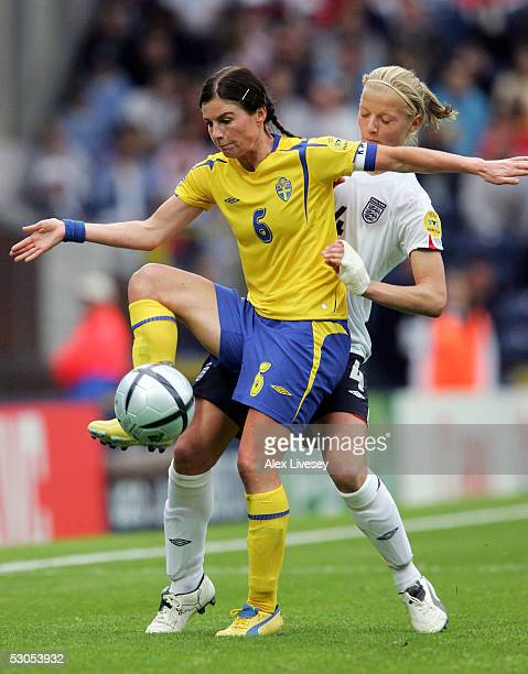 Malin Mostrom of Sweden holds off a challenge from Katie Chapman of England during the Women's UEFA European Championship 2005 Group A game between...