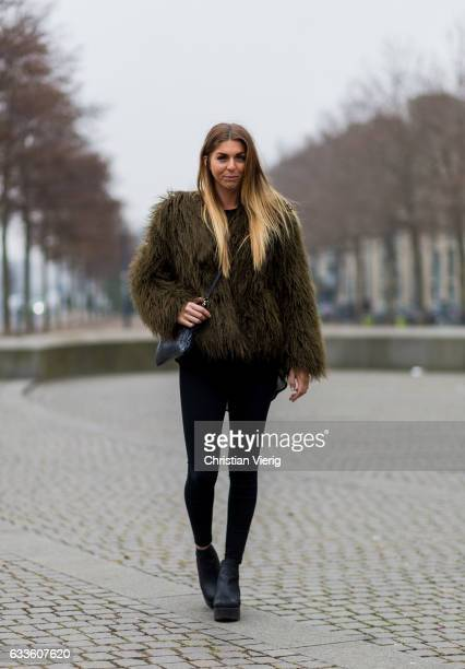 Malin Svensson wearing an olive fur jacket, black leggings, ankle boots during the Copenhagen Fashion Week Autumn/Winter 17 on February 2, 2017 in...