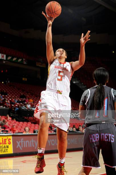 Malina Howard of the Maryland Terrapins drives to the hoop against the Delaware State Hornets at the Comcast Center on December 14 2013 in College...