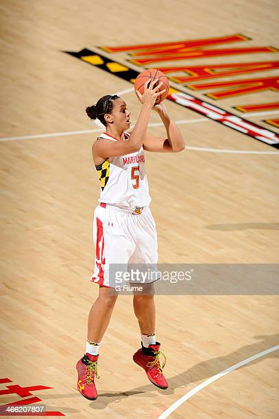 Malina Howard of the Maryland Terrapins shoots the ball against the Delaware State Hornets at the Comcast Center on December 14 2013 in College Park...