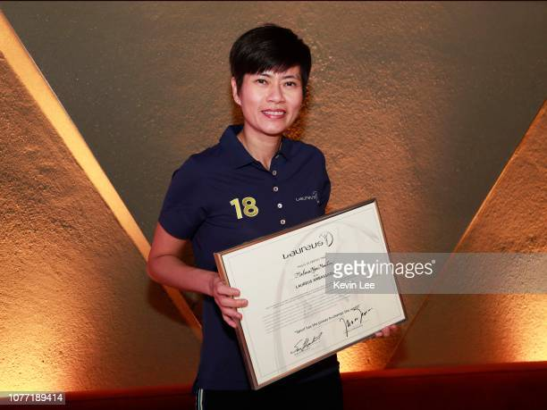 Malina Ngai Man Lin poses with the certificate before the Laureus Hong Kong Ambassador Announcement ceremony at Mercedes Me Store on December 04 2018...