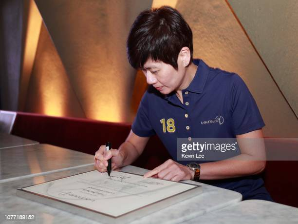 Malina Ngai Man Lin signs the certificate before the Laureus Hong Kong Ambassador Announcement ceremony at Mercedes Me Store on December 04 2018 in...