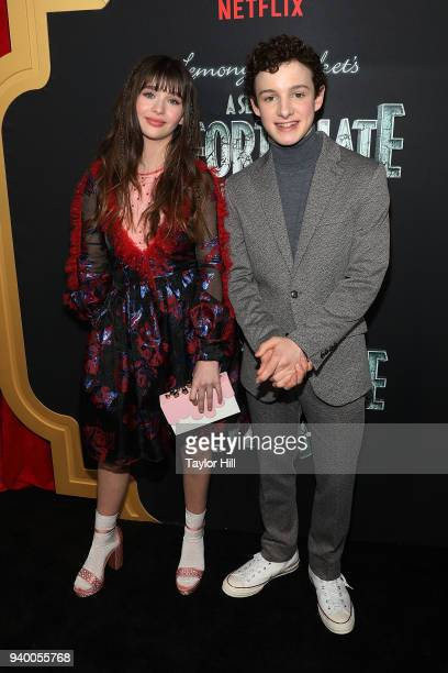 Malina Weissman and Louis Hynes attend the the Season 2 premiere of Netflix's 'A Series Of Unfortunate Events' at Metrograph on March 29 2018 in New...
