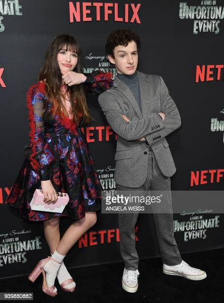 Malina Weissman and Louis Hynes attends the Netflix Premiere of 'A Series of Unfortunate Events' Season 2 on March 29 2018 in New York City / AFP...