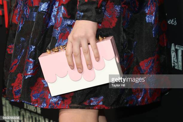 Malina Weissman handbag detail attends the the Season 2 premiere of Netflix's 'A Series Of Unfortunate Events' at Metrograph on March 29 2018 in New...