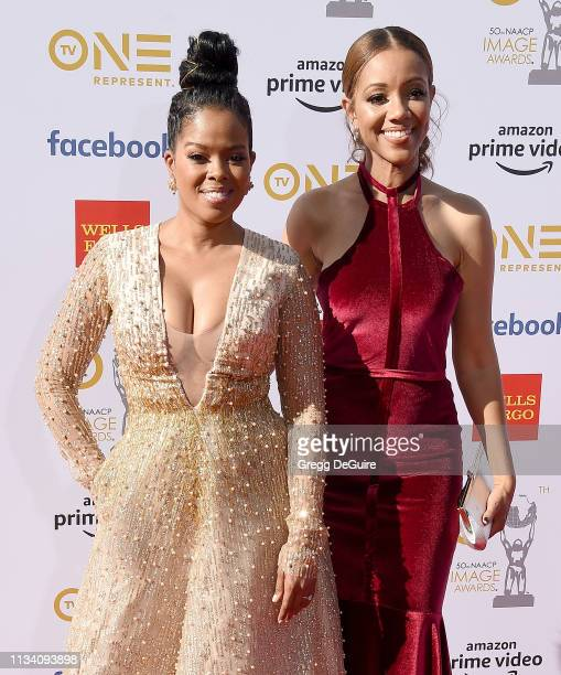 Malinda Williams and Chrystee Pharris arrive at the 50th NAACP Image Awards at Dolby Theatre on March 30 2019 in Hollywood California
