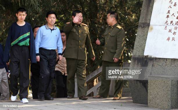 TO GO WITH STORY 'CHINAVIETNAMWARHISTORY' Chinese PLA officers and officials arrive for a ceremony at the Chinese military's 'Martyr's Cemetery' from...