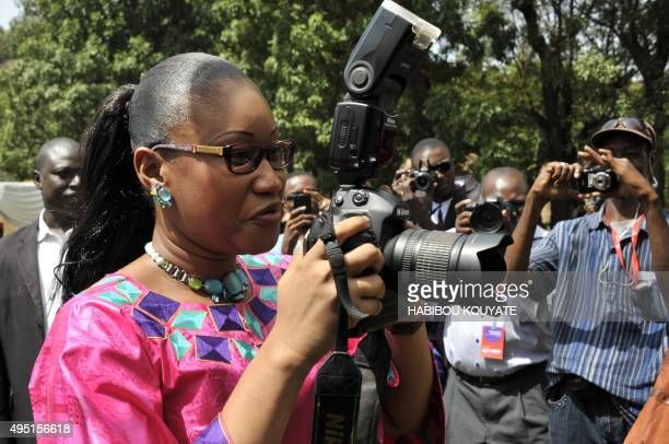 Mali's Culture and Tourism Minister NDiaye Ramatoulaye Diallo holds a camera during the opening of the 10th edition of the Bamako Encounters African...