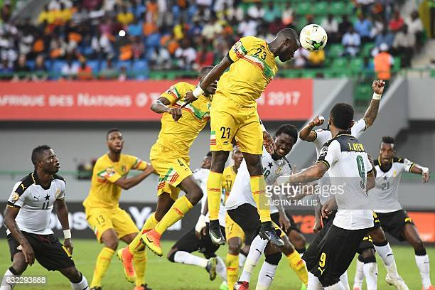 TOPSHOT Mali's defender Ousmane Coulibaly jumps amid players to head the ball during the 2017 Africa Cup of Nations group D football match between...