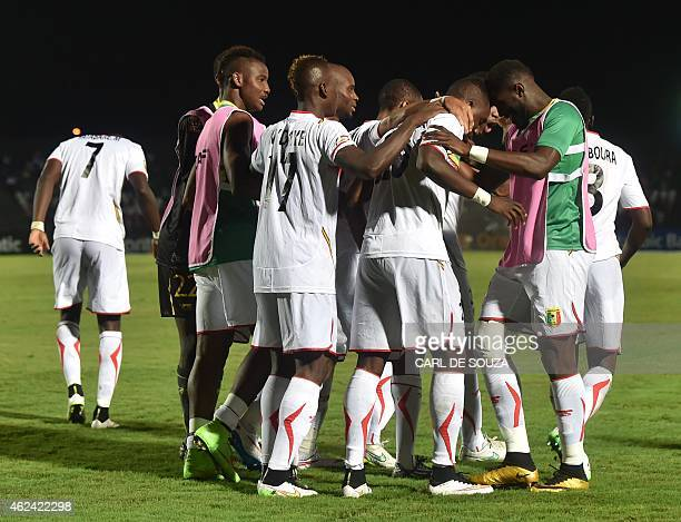 Mali's forward Modibo Maiga is congratulated by teammates after scoring a goal during the 2015 African Cup of Nations group D football match between...