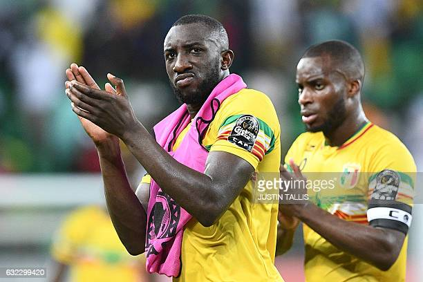 Mali's forward Moussa Marega and Mali's midfielder Yacouba Sylla acknowledge supporters at the end of the 2017 Africa Cup of Nations group D football...