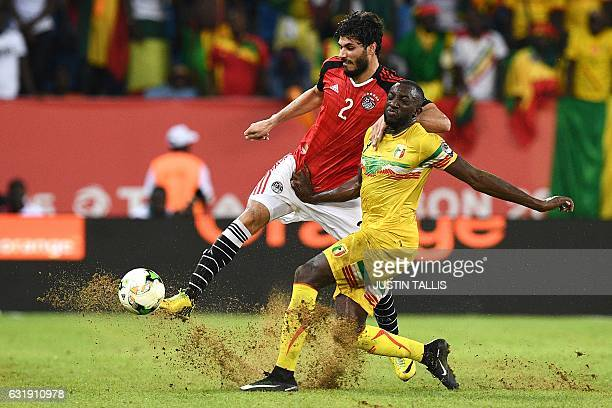 TOPSHOT Mali's forward Moussa Marega challenges Egypt's defender Ali Gabr during the 2017 Africa Cup of Nations group D football match between Mali...